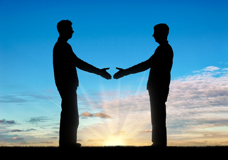 Silhouette two men intend to shake hands. Greeting concept, business partners