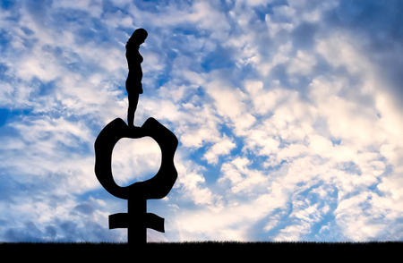 Silhouette of a sad woman standing on a female gender symbol that became flabby and wrinkled. Conceptual image about the inevitable menopause in women