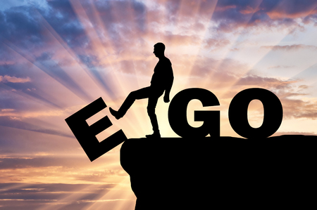 Silhouette of a man gets rid of the ego as a bad habit. Conceptual image of the fight against egoism Stock fotó