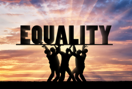 A group of people hold the word equality over them. The notion of equal rights in society
