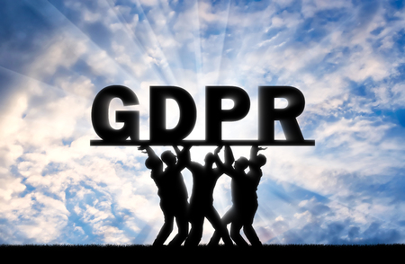 A group of people hold the word GDPR above them. Conceptual image about the law GDPR Imagens