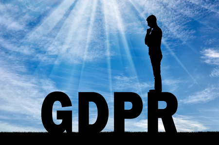 Silhouette pensive man standing on the word GDPR. Conceptual image about the law GDPR