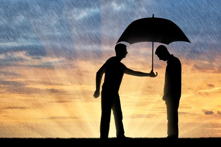 Altruist man shares an umbrella with another sad man standing in the rain. Concept of Altruism in society Stock fotó