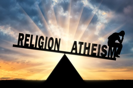 A frustrated man made a choice in favor of atheism and not religion on the scales. The concept of atheism and atheist