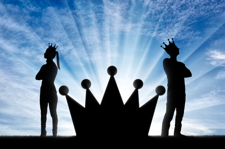 A big crown between an arrogant man and a woman with a crown on her head, they stand with their backs to each other. Concept of selfishness and arrogance in society