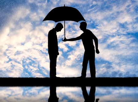 Altruist man gives his umbrella to another sad man standing in the rain. Altruism concept Imagens