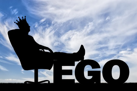 Selfish man sitting on an office chair with a crown on his head having thrown back his feet on the word ego. Big Ego Concept