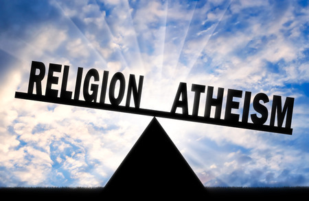 Word atheism is more powerful than the word religion on the scales. Concept of atheism Imagens