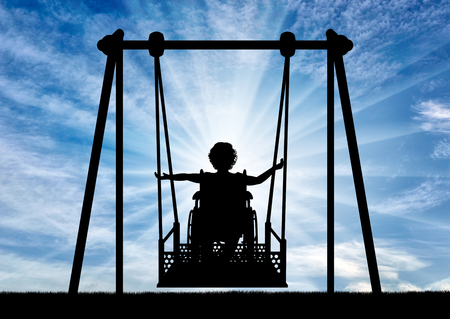 Lifestyle of children with disabilities. Happy child is disabled in a wheelchair on an adaptive swing for disabled children.