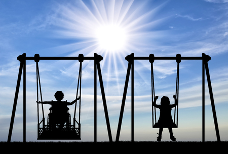 Happy child is handicapped in a wheelchair on an adaptive swing having fun with a healthy child together. Concept of the lifestyle of children with disabilities and their support with adaptive equipment