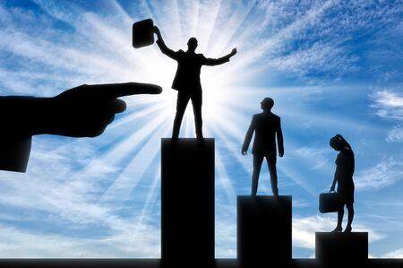 Hiring concept. Silhouette of a hand indicates the silhouette of a jubilant man standing on the winner's podium, next to an upset man and woman