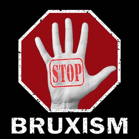 Stop bruxism conceptual illustration. Open hand with the text stop bruxism. Stock Photo