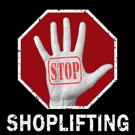 Stop shoplifting conceptual illustration. Open hand with the text stop shoplifting. Global social problem 写真素材