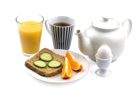 A good breakfast with tea, bread, orange juice, eggs and fruit photo