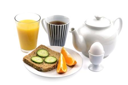 A good breakfast with tea, bread, orange juice, eggs and fruit photo