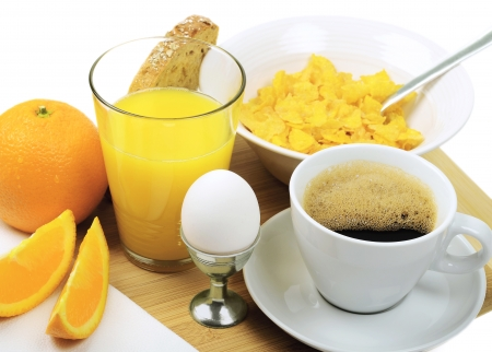 A good breakfast with coffee, juice, eggs, bread, cornflakes and orange