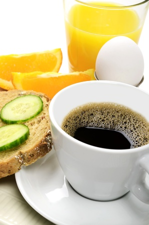 A good breakfast with coffee, juice, eggs and bread photo