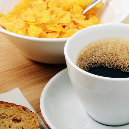 Breakfast with cereals, bread and a cup of coffee photo