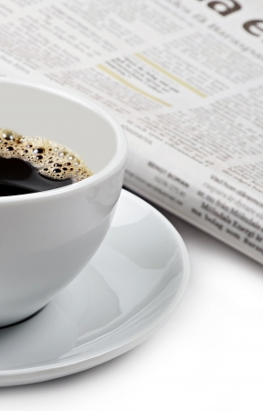 brewed: A cup of good hot coffee and a newspaper