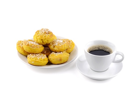 Swedish saffron bun and a cup of coffee, isolated against a white background Stock Photo - 16934990