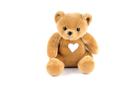 Teddy bear with a patch on the chest, in the form of a heart photo