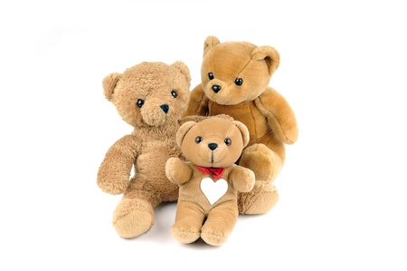 teddy: Three teddy bears, one has a patch in the shape of a heart on the chest Stock Photo