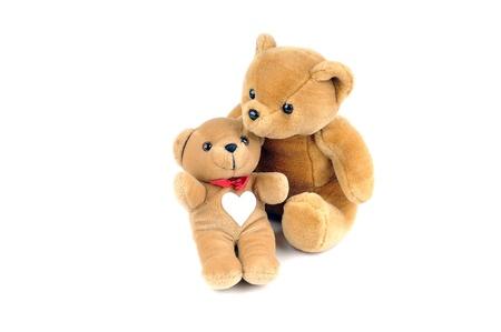 osos de peluche: Dos osos de peluche, una tiene un parche en forma de un coraz�n en el pecho Foto de archivo