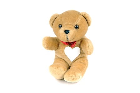 A small Teddy bear with a patch on the chest, in the form of a heart photo
