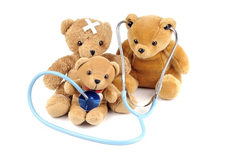 sick teddy bear: Three teddy bears and a stethoscope
