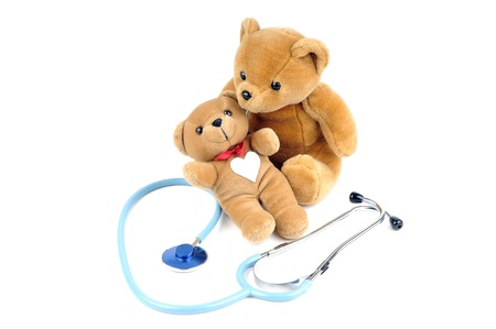 A stethoscope and two teddy bears photo