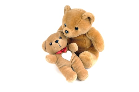 Two teddy bears, one has a patch in the shape of a heart on the chest photo