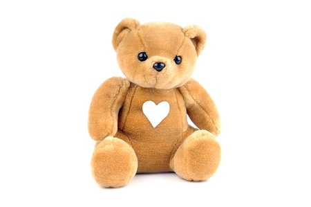 Teddy bear with a sticking plaster in the form of a heart photo