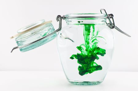 An antique jar full of water with green colour. Stock Photo - 3230520