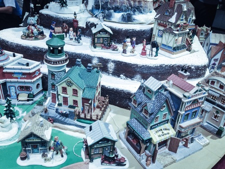 wherever: Miniature village showing winter season. Snows wherever the streets a man giving gift to a child.. Favorite season of the year