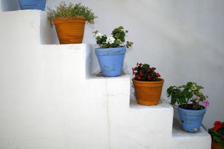 Flower pots on steps - Paros island, Greece