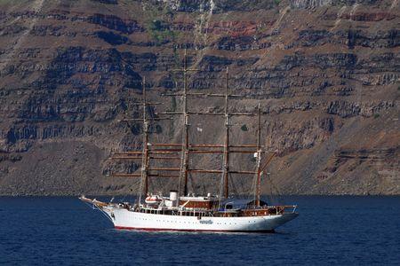 coast line: Sail boat of the coast of Santorini Island, Greece Stock Photo