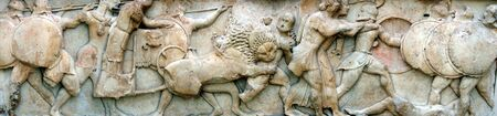 greek gods: panoramic image of frieze depicting ancient battle between gods and giants