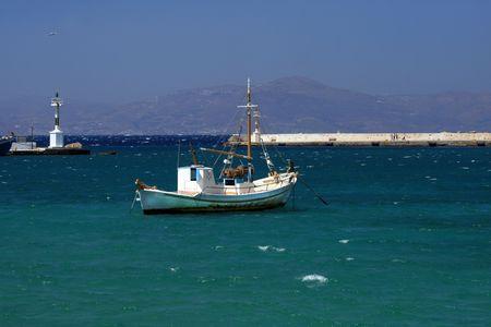 Traditional fishing boat at Mykonos harbor, Greece photo
