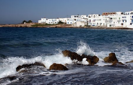 Crashing waves with the town of Naoussa - Paros, Greece Stock Photo - 1950433