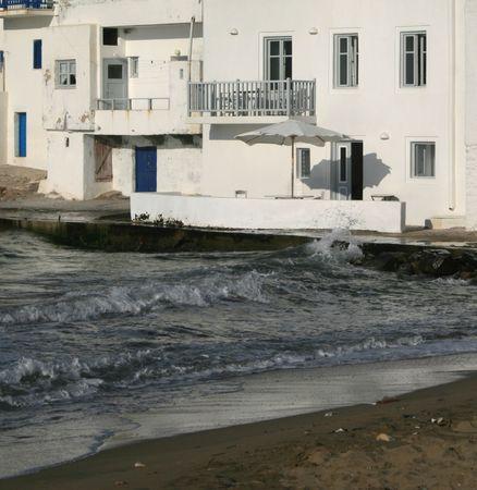 verandas: Naoussa beach and homes - Paros island, Greece Stock Photo