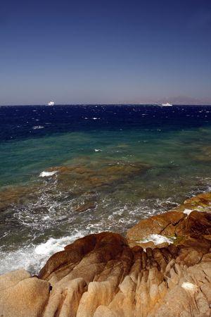 verandas: Mykonos rocky beach - Greece Stock Photo