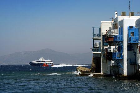 verandas: Mykonos small venice and high speed ferry departing - Greece