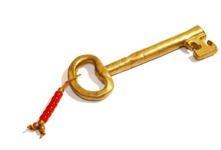 Gold clave del �xito - aislados sobre fondo blanco
