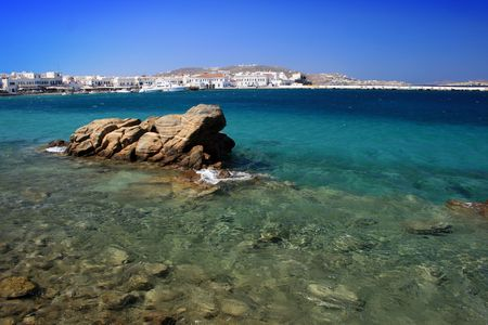 Mykonos beach with view of the town and old harbor, Greece Stock Photo - 2020841