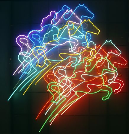 Neon horses racing against dark background