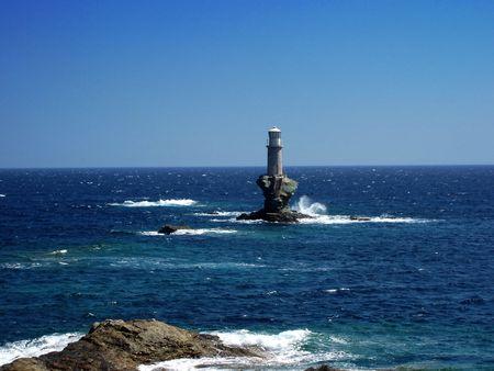 coast line: Andros island light house, Greece    Stock Photo