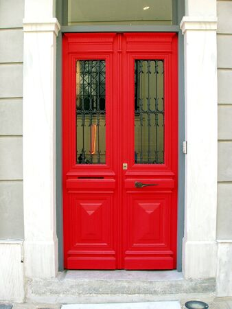 Red door from restored neoclassical home in Athens, Greece       photo