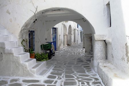 Narrow street of a traditional greek island village.  Paros, Greece Stock Photo