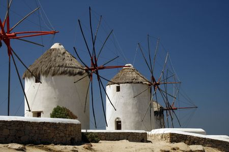 well known: The famous windmills of Mykonos Island.  Little Venice can be seen in the background.