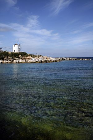 Beach on Paros Island with view of windmill - Greece photo